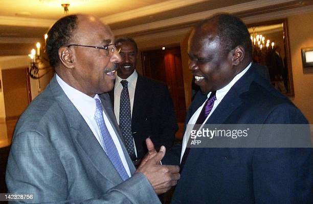 Sudan's Minister of Defence Abdel Rahim Mohamed Hussein greets Pagan Amum chief negotiator for South Sudan ahead of security talks in Addis Ababa on...