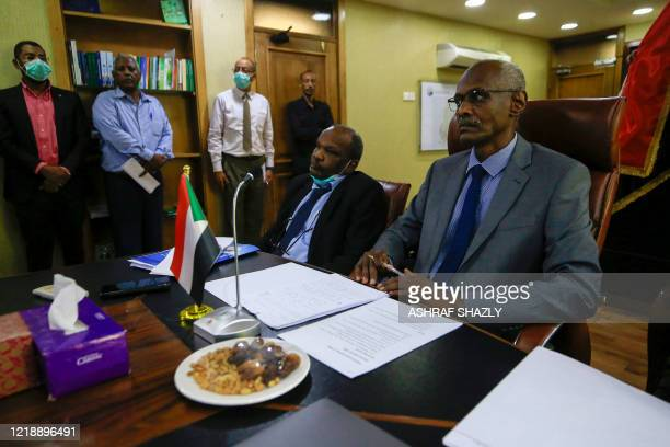 Sudan's Minister of Irrigation and Water Resources Yasir Mohamed takes part in a video meeting at the ministry in Khartoum on June 9 over the Grand...