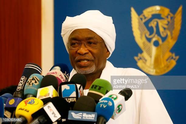 Sudan's newly appointed vicepresident Mohamed Osman Yousif Kiber addresses journalists after taking the oath in Khartoum on September 10 2018 Sudan's...