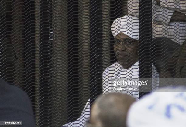Sudan's ousted President Omar alBashir sits in a defendant's cage during his trial of illegal acquisition and use of foreign funds in Khartoum Sudan...
