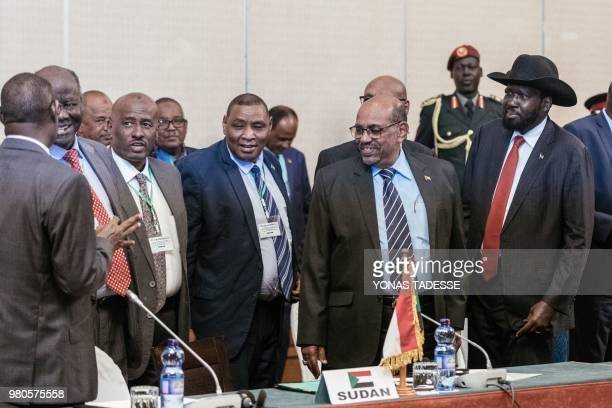 Sudan's President Omar alBashir and South Sudan's President Salva Kiir react during the 32nd Extraordinary Summit of Intergovernmental Authority on...