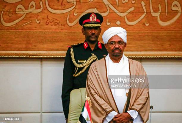 Sudan's President Omar alBashir attends a meeting with his new 20member cabinet as they take oath at the presidential palace in the capital on March...