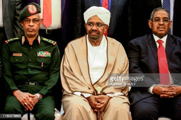 Sudan's President Omar alBashir is seated alongside his first vice president Lieutenant General Awad Mohamed Ahmed ibn Auf and Prime Minister Mohamed...