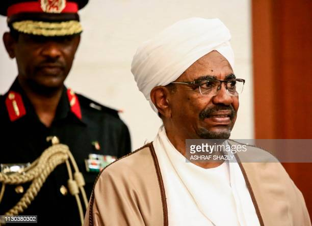 Sudan's President Omar alBashir meets with his new 20member cabinet as they take oath at the presidential palace in the capital on March 14 2019...