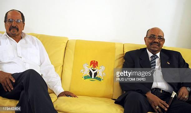 Sudan's President Omar alBashir poses flanked by Saharawi Arab Democratic Republic President Mohamed Abdelaziz at the Nnamdi Azikiwe International...