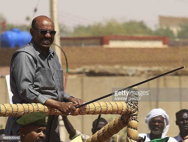 Sudan's President Omar alBashir stands on a pickup truck during a campaign rally for the upcoming presidential elections in ElFasher in North Darfur...