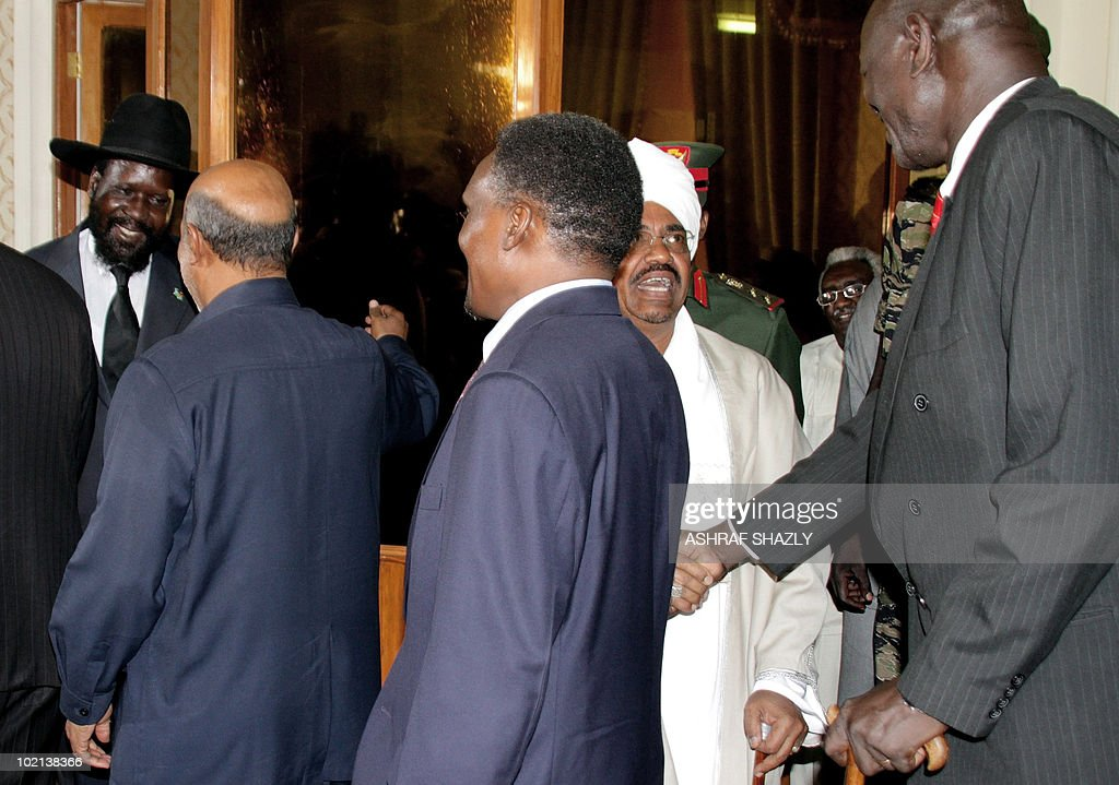 Sudan's President Omar al-Beshir (R) and Southern Sudan President Salva Kiir (L) shake hands with the new members of parliament after they were sworn in, on June 16, 2010, in Khartoum. The new government, consisting of 24 members of the president's National Congress Party, eight members of the former southern rebel Sudan People's Liberation Movement and three small parties, must tread carefully to reach the key referendum on independence for south Sudan scheduled for January.