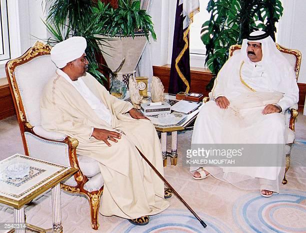 Sudan's President Omar alBeshir sits with Qatar's Sheikh Hamad bin Khalifa alThani during a meeting 28 September 2003 in Doha Beshir arrived in Qatar...