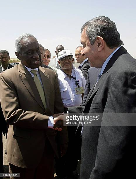 Sudan's Second Vice President Ali Osman Taha welcomes Egyptian Prime Minister Essam Sharaf upon his arrival at Khartoum's airport on March 27 2011 as...