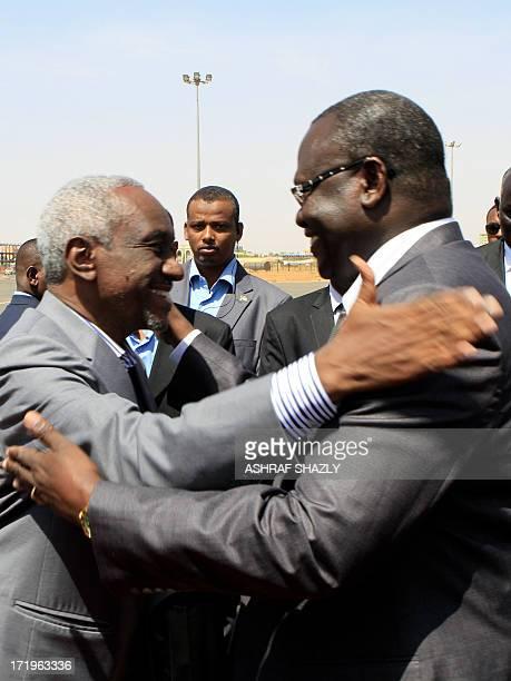 Sudan's Vice President Ali Osman Taha greets his South Sudanese counterpart Riek Machar upon the latter's arrival at Khartoum ariport on June 30 2013...