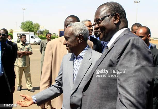 Sudan's Vice President Ali Osman Taha welcomes his South Sudanese counterpart Riek Machar upon the latter's arrival at Khartoum ariport on June 30...