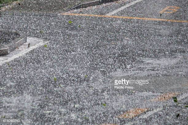 A sudden hailstorm hit the city of Turin making the road surface white as if there was snow