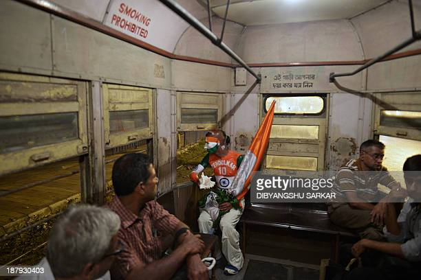 Sudhir Kumar Chaudhary a fan of Indian cricketer Sachin Tendulkar rides a tram following a cricket match in Kolkata on November 8 2013 Chowdhury who...