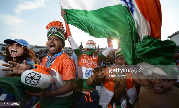 Sudhir Kumar Chaudhary and other India fans react as Rohit Sharma reaches his century during the 1st Royal London OneDay International between...