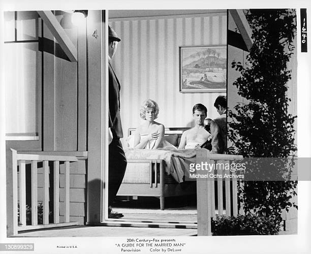 Sue Ane Langdon and Robert Morse are caught in bed in a scene from the film 'A Guide For the Married Man' 1967