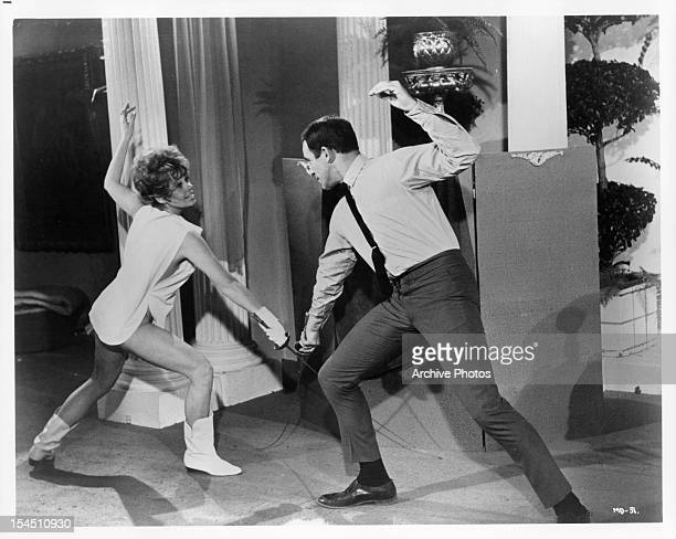 Sue Ane Langdon fences Paul Mantee in a scene from the film 'A Man Called Dagger' 1968