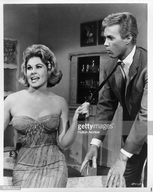 Sue Ane Langdon grabs Harve Presnell necktie in the movie When the Boys Meet the Girls circa 1965