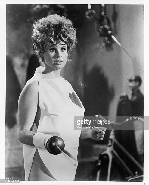 Sue Ane Langdon holds her sword in a scene from the film 'A Man Called Dagger' 1968