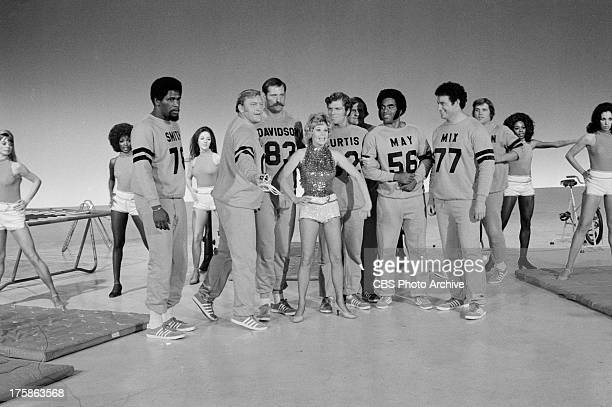 Sue Ane Langdon surrounded by Bubba Smith Jim Otto Ben Davidson Mike Curtis Ray May and Ron Mix on the SECOND SUPER COMEDY BOWL Image dated November...