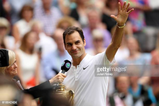 Sue Barker interviews Roger Federer of Switzerland as he celebrates victory with the trophy after the Gentlemen's Singles final against Marin Cilic...