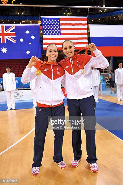 Sue Bird and Diana Taurasi of the U.S. Women's Senior National Team celebrate after winning the gold medal against Australia at the Beijing Olympic...