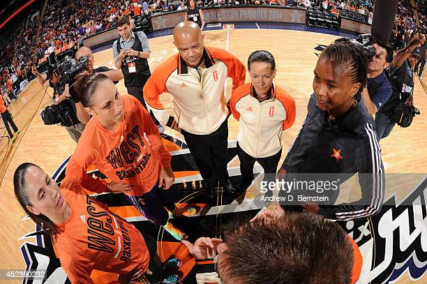 Sue Bird and Diana Taurasi of the Western Conference AllStars and Tamika Catchings of the Eastern Conference AllStars meet at center court before the...