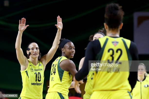 Sue Bird and Jewell Loyd of the Seattle Storm celebrate a three pointer against the Washington Mystics in the first half during game three of the...