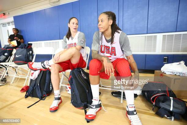 Sue Bird and Seimone Augustus sit on the bench during Women's Senior US National Team practice on September 10 2014 in Annapolis MD NOTE TO USER User...