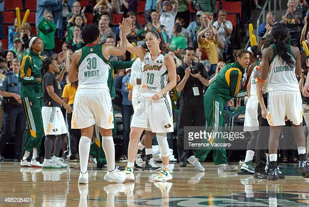 Sue Bird and Tanisha Wright of the Seattle Storm celebrate against of the Tulsa Shock during the game on June 12014 at Key Arena in Seattle...