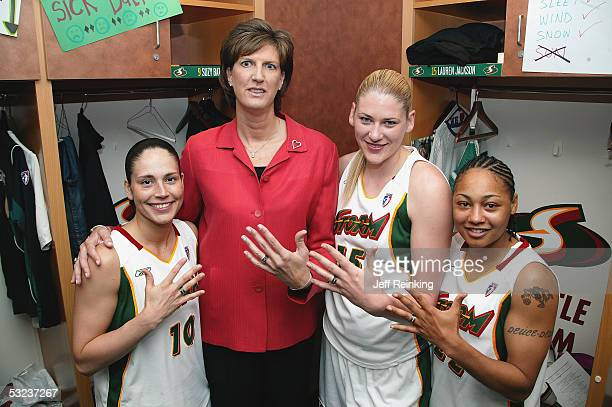 Sue Bird head coach Anne Donovan Lauren Jackson and Betty Lennox of the Seattle Storm pose with their WNBA Championship rings at their game against...