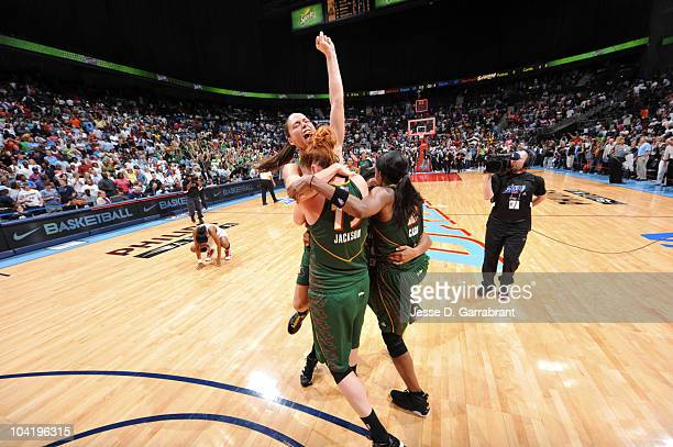 Sue Bird, Lauren Jackson and Swin Cash of the Seattle Storm celebrates after defeating the Atlanta Dream in Game Three of the 2010 WNBA Finals on...