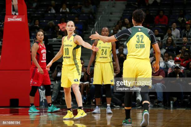 Sue Bird of the Seattle Storm and Alysha Clark of the Seattle Storm high five each other during the game against the Washington Mystics during a WNBA...
