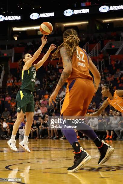 Sue Bird of the Seattle Storm attempts a three point shot against the Phoenix Mercury during game three of the WNBA Western Conference Finals at...