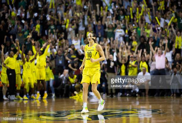 Sue Bird of the Seattle Storm backpedals to defend as the crowd erupts after she made a 3pointer from over 30 feet against the Washington Mystics...
