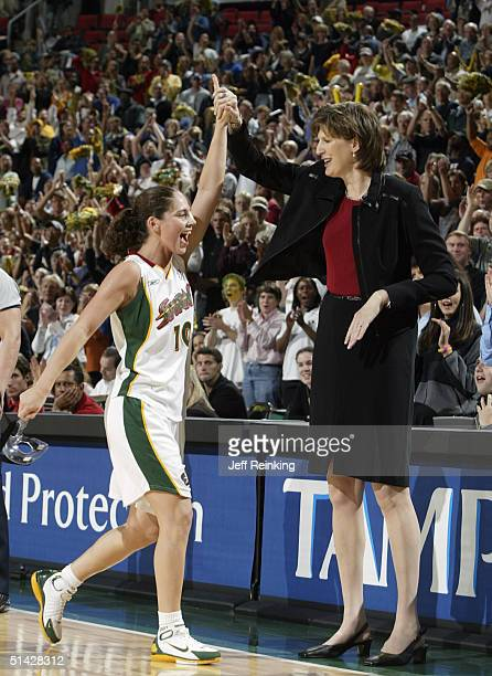 Sue Bird of the Seattle Storm celebrates with Storm coach Anne Donovan in the final minute of their victory over the Sacramento Monarchs during Game...