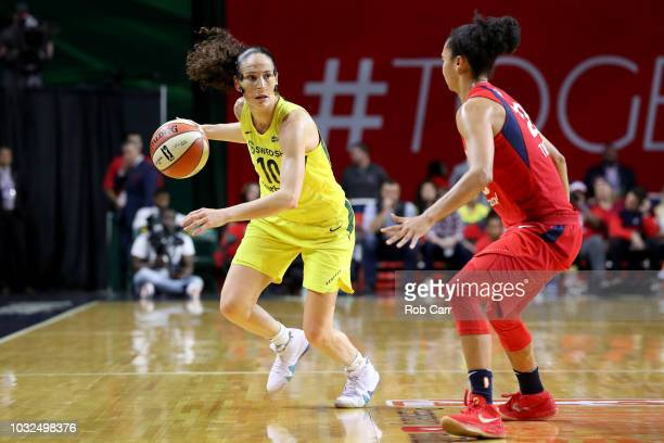 Sue Bird of the Seattle Storm dribbles the ball against Kristi Toliver of the Washington Mystics in the first half during game three of the WNBA...