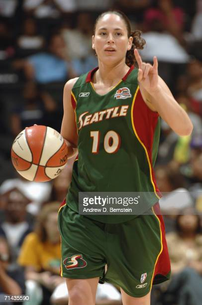 Sue Bird of the Seattle Storm dribbles the ball into position against the Los Angeles Sparks at the Staples Center on June 28 2006 in Los Angeles...