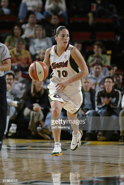 Sue Bird of the Seattle Storm drives against the Detroit Shock during the game at Key Arena on September 8 2004 in Seattle Washington The Storm won...