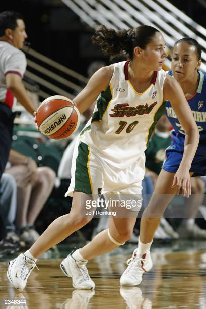 Sue Bird of the Seattle Storm drives the ball during the game against the New York Liberty at Key Arena on July 23 2003 in Seattle Washington The...
