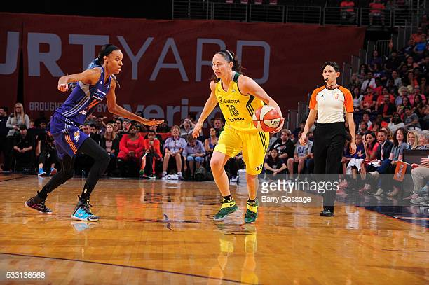 Sue Bird of the Seattle Storm handles the ball against DeWanna Bonner of the Phoenix Mercury on May 20 2016 at Talking Stick Resort Arena in Phoenix...