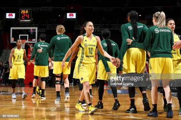Sue Bird of the Seattle Storm high fives her teammates during the game against the Washington Mystics during a WNBA game on September 1 2017 at the...