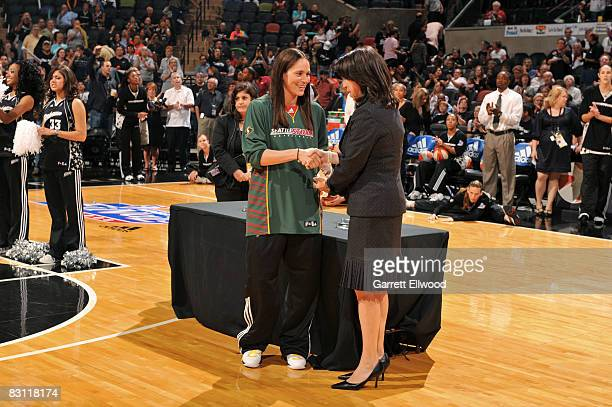 Sue Bird of the Seattle Storm is presented 2008 All WNBA First Team by Donna Orender WNBA President prior to Game Two of the WNBA Finals on October 3...