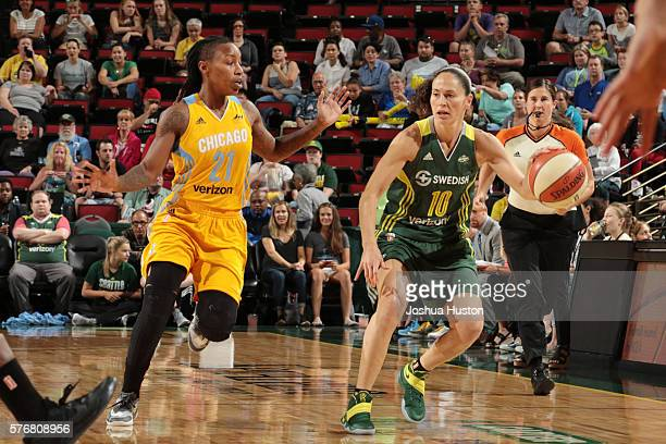 Sue Bird of the Seattle Storm moves the ball against Jamierra Faulkner of the Chicago Sky on July 17 at Key Arena in Seattle Washington NOTE TO USER...