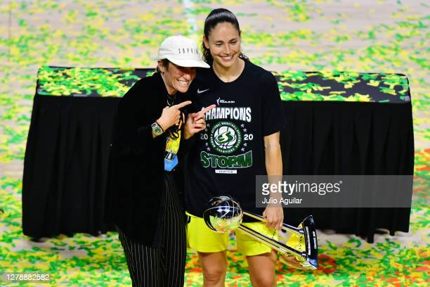 Sue Bird of the Seattle Storm poses with Megan Rapinoe after defeating the Las Vegas Aces 9259 to win the WNBA Championship following Game 3 of the...
