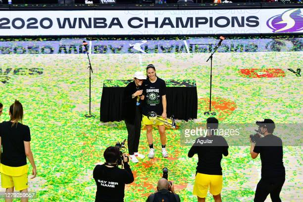 Sue Bird of the Seattle Storm poses with Megan Rapinoe while holding the WNBA Championship trophy after defeating the Las Vegas Aces 9259 in Game 3...