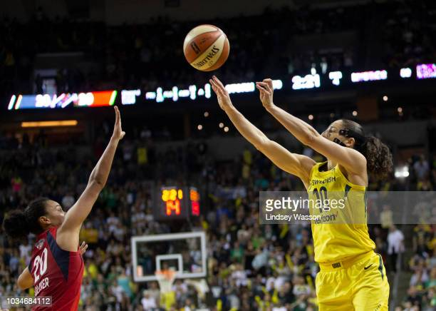 Sue Bird of the Seattle Storm shoots over Kristi Toliver of the Washington Mystics during the second half of Game 2 of the WNBA Finals at KeyArena on...