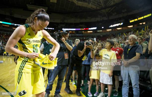 Sue Bird of the Seattle Storm signs a pair of shoes after the game against the Phoenix Mercury during a WNBA game on August 27 2017 at Key Arena in...