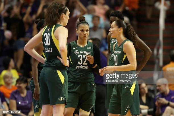 Sue Bird of the Seattle Storm talks with Breanna Stewart and Alysha Clark during game three of the WNBA Western Conference Finals against the Phoenix...