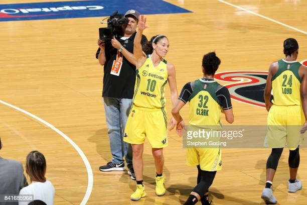 Sue Bird of the Seattle Storm waves to the crowd after breaking the WNBA alltime Career assists record during the game against the Washington Mystics...