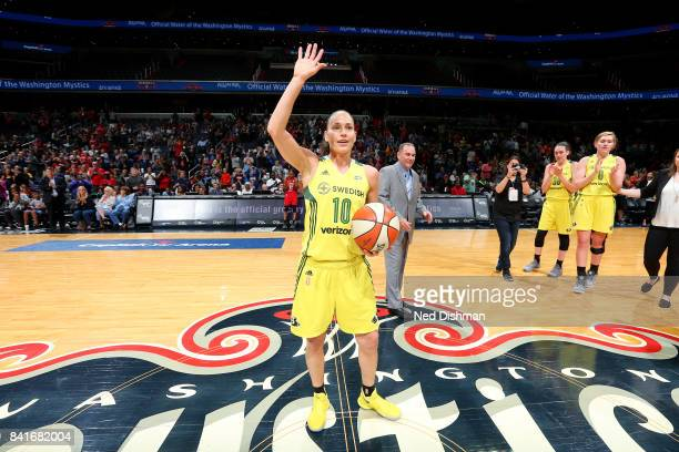 Sue Bird of the Seattle Storm waves to the crowd in honor of her breaking the WNBA career assist record during the game against the Washington...